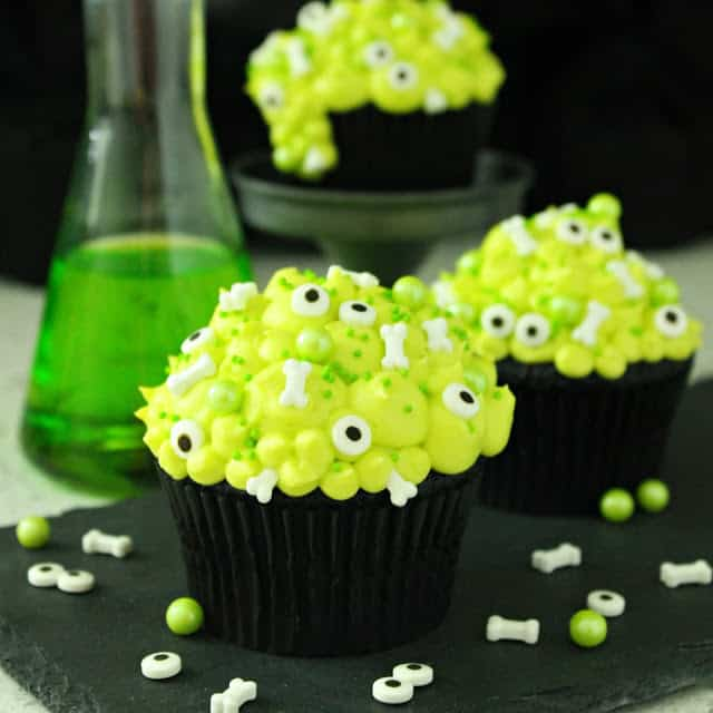 Black Velvet Cauldron Halloween Cupcakes with Skeleton Bones and Eyeball sprinkles